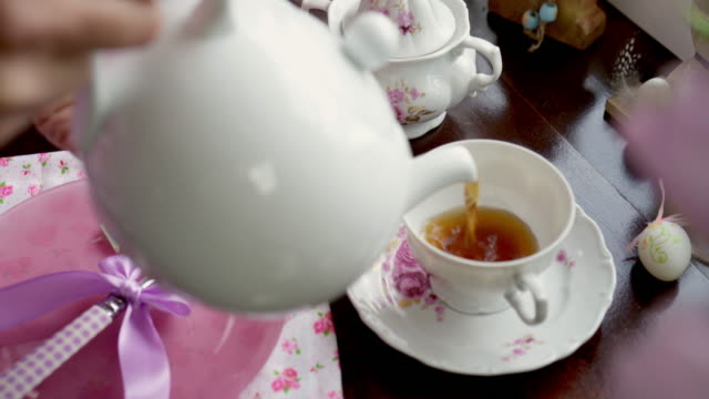 drinking cup of fruit tea for easter - tea cup stock videos & royalty-free footage