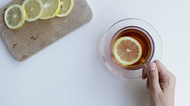 drinking cup of tea with lemon slice - tea cup stock videos & royalty-free footage