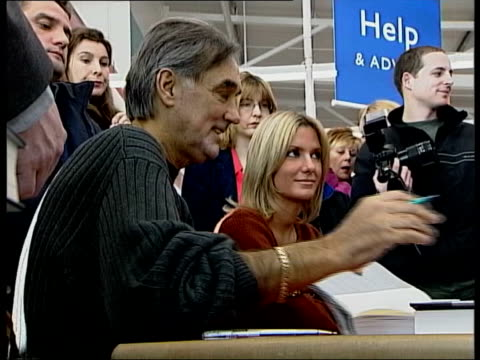 doctor who treated george best addresses belfast schoolchildren tx england london int george best at book signing with the wife alex george and alex... - doctor who stock videos and b-roll footage