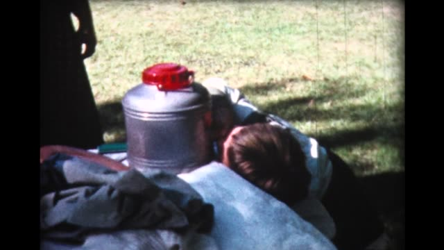 1961 drinking from large thermos bottle - picnic table stock videos & royalty-free footage