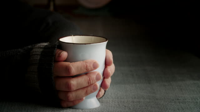 drinking hot herbal tea from a cup - teapot stock videos & royalty-free footage