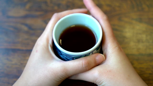 pov drinking hot japanese tea - tea cup stock videos & royalty-free footage
