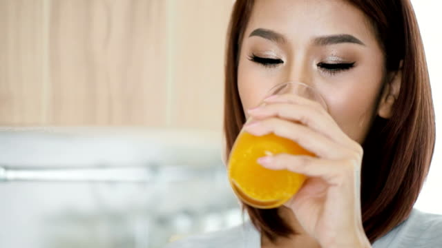 drinking orange juice - juice drink stock videos & royalty-free footage