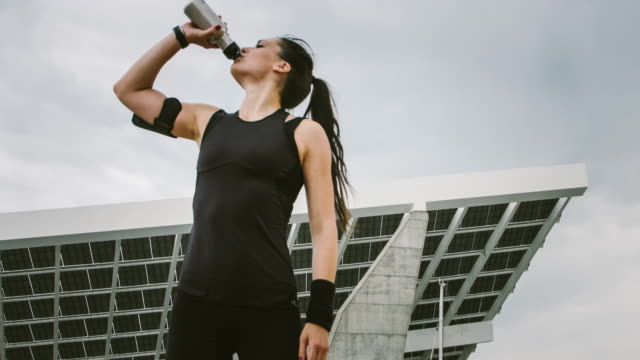 drinking water after the exercises - pedal pushers stock videos & royalty-free footage