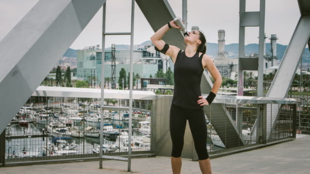 drinking water after the running - pedal pushers stock videos & royalty-free footage