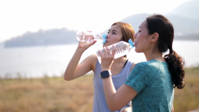 drinking water after workout - warm up exercise stock videos & royalty-free footage
