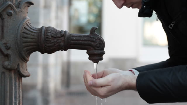 Drinking Water at the Fountain