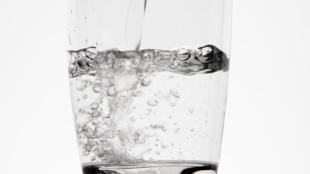 drinking water being poured into glass - transparent stock videos & royalty-free footage