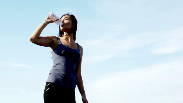 Drinking water from a bottle. MS