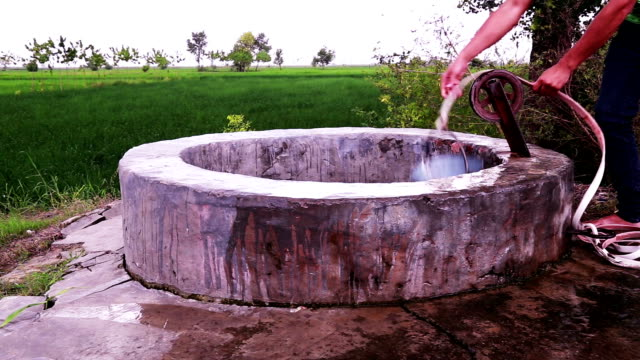 drinking water well - pulling stock videos & royalty-free footage