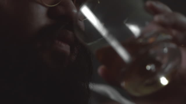 drinking whiskey - close up stock videos & royalty-free footage