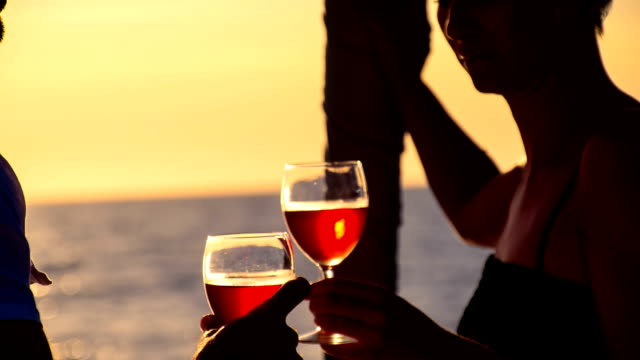 cu drinking wine on a sailboat at dusk - yacht stock videos & royalty-free footage