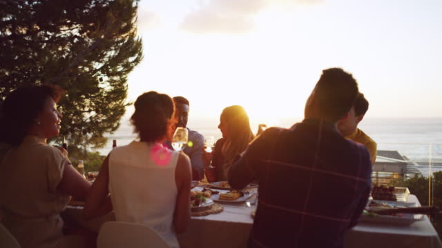 drinks go up when the sun goes down - tetto video stock e b–roll