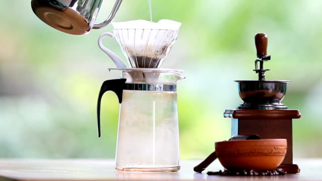 drip coffee process. pouring a boiling water over the grounds. - drip bag stock videos and b-roll footage