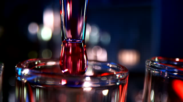 super slo mo dripping liquid into test tubes - nanotechnology stock videos & royalty-free footage