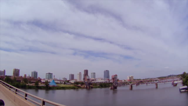 Drive across Arkansas River with downtown Little Rock skyline in background