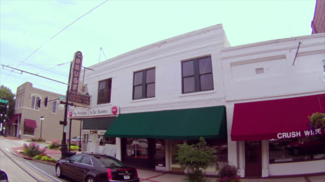 drive along downtown street featuring north little rock old time drug store with coca-cola signs - arkansas stock videos & royalty-free footage