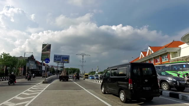 pov drive along sunset avenue in kuta in bali - tracking shot stock videos & royalty-free footage