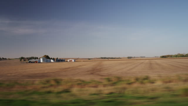 drive by harvested midwestern farm fields in the distance. - iowa stock videos & royalty-free footage