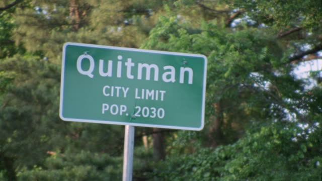 "drive by small town highway sign, ""quitman city limit pop. 2030��€ - place sign stock videos & royalty-free footage"