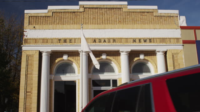"drive by small town, rural newspaper office: ""the adair news."" - small office stock videos & royalty-free footage"