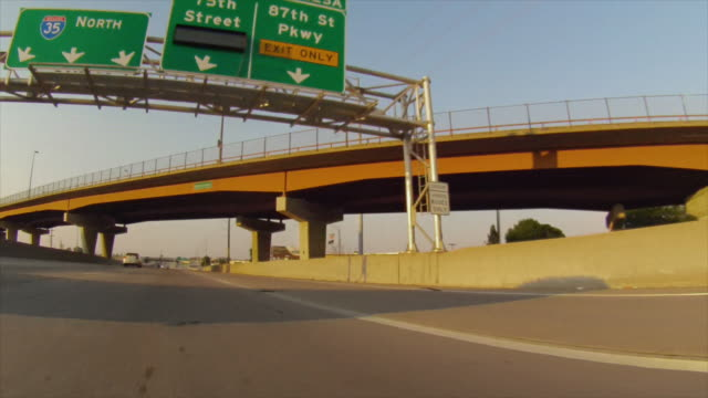 Drive down interstate highway passing under overpass