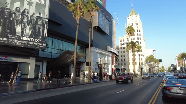 drive in hollywood boulevard at sunset in the spring of 2021 amid the covid-19 pandemic. - viale video stock e b–roll