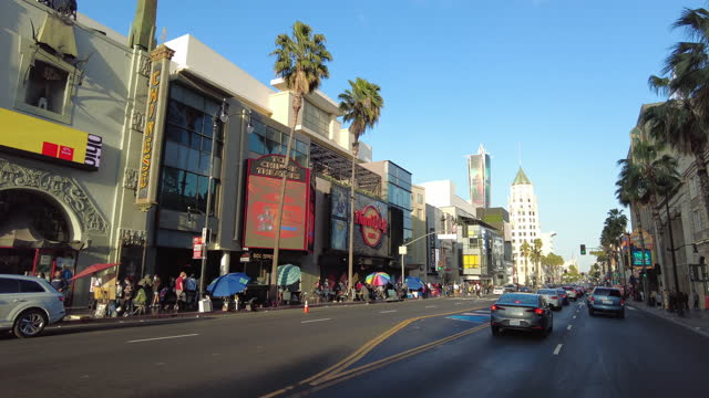 drive in hollywood boulevard at sunset in the spring of 2021 amid the covid-19 pandemic. - tcl chinese theatre stock videos & royalty-free footage