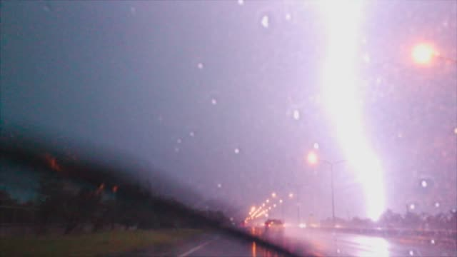 drive in rain and lightning - temporale video stock e b–roll