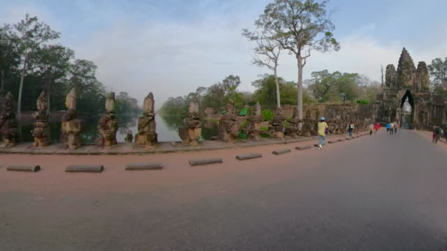 pov / a drive on causeway to south gate, entrance of angkor thom - ancient stock videos & royalty-free footage