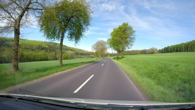 POV drive on country road in spring, Vogelsberg, Hesse, Germany