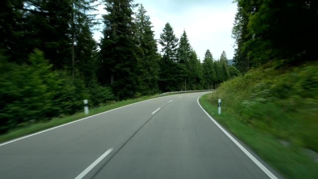 pov drive on country road (federal road 500 schwarzwaldhochstrasse) in summer, black forest, baden-württemberg, germany - naturwald stock-videos und b-roll-filmmaterial
