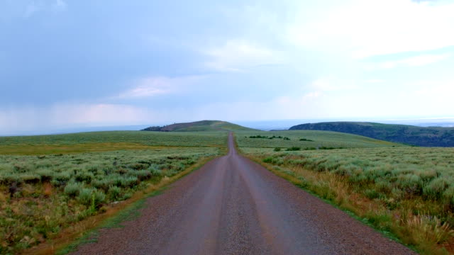 Drive on gravel road in open plain Summit Steens Mountain Near Malhuer Wildlife Refuge 20