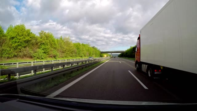 pov drive on highway a7 with truck, baden-wurttemberg, germany - car point of view stock videos & royalty-free footage