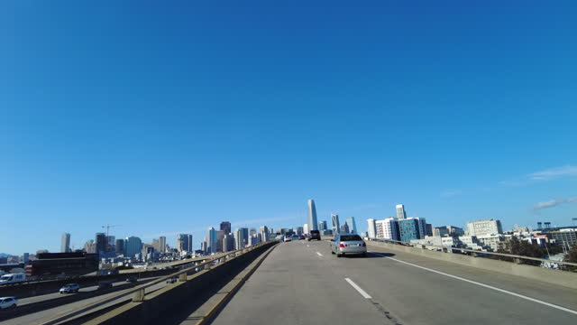 drive on the elevated road in the rush hour with san francisco cityscape in the background amid the covid-19 pandemic. - copy space stock videos & royalty-free footage