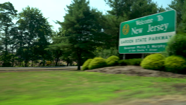 stockvideo's en b-roll-footage met drive shot of the welcome to new jersey - highway sign - new jersey