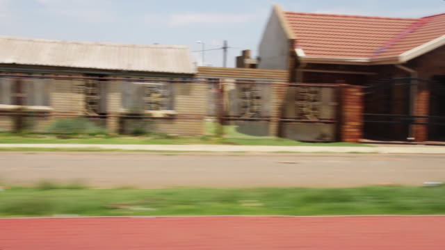 a drive through johannesburg - soweto stock videos & royalty-free footage
