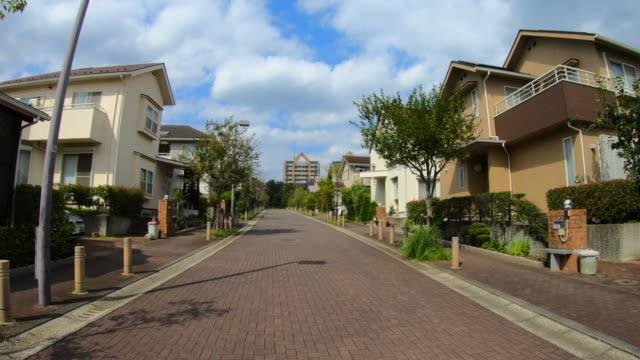 drive through residential area - sidewalk stock videos & royalty-free footage