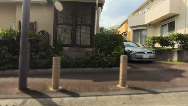 drive through residential area - plusphoto stock videos & royalty-free footage