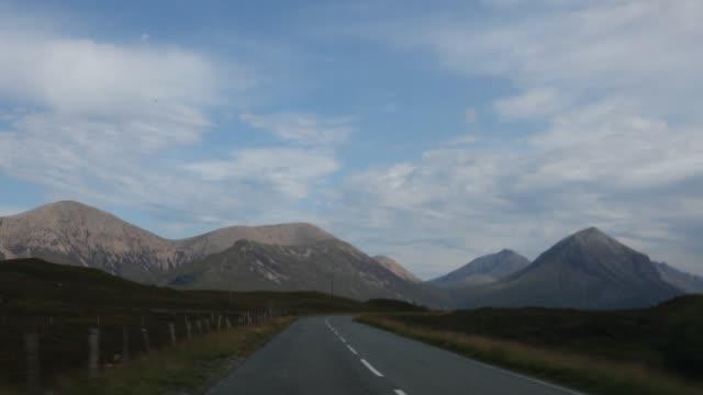 drive through the highlands on a country road. - ländliche straße stock-videos und b-roll-filmmaterial