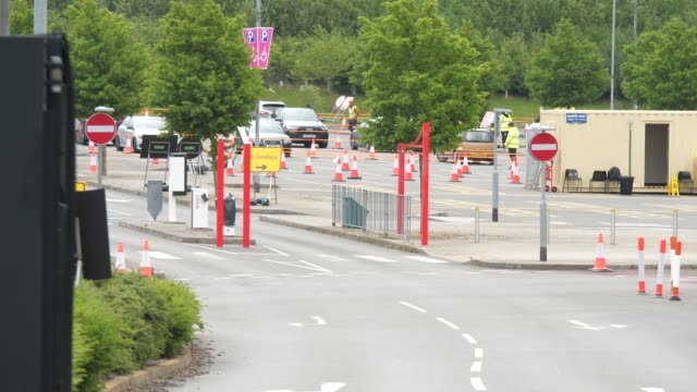 drive thru coronavirus testing location at birstall park and ride. various shots of the car park site being used as a testing facility. leicester has... - exam stock videos & royalty-free footage