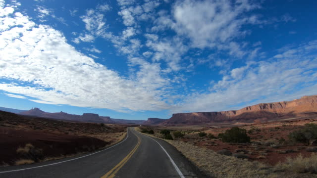 drive towards arches national park, moab, utah - dividing line stock videos & royalty-free footage