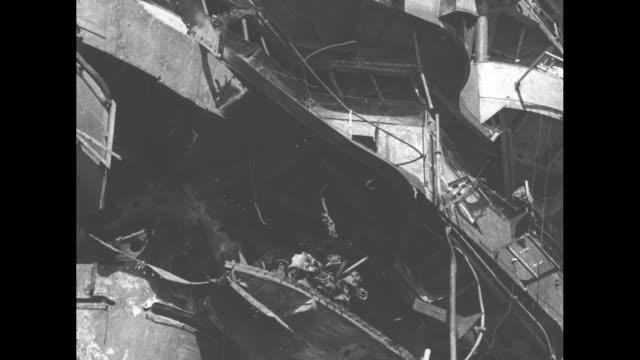 vídeos de stock e filmes b-roll de driveby shot damaged japanese battleship nagato / japanese officer walks on deck of nagato waving his cap / japanese characters written in chalk on... - navio de batalha