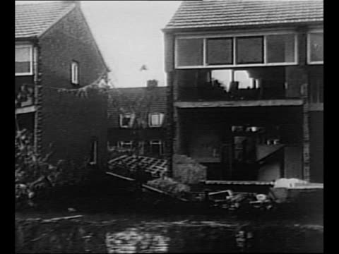 driveby shot rows of apartment buildings destroyed by flood in the netherlands / water moves to shore tilt down shoe on shore / aerial flooded area... - {{ collectponotification.cta }} stock videos & royalty-free footage