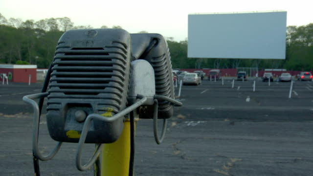 ms, drive-in movie theater, speakers in foreground, wellfleet, massachusetts - audio electronics stock videos and b-roll footage
