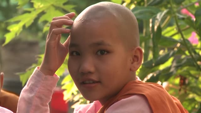 stockvideo's en b-roll-footage met driven from their homes by conflict and poverty thousands of young girls don nuns robes to lead a safe but austere life in myanmar's biggest city... - non urban scene