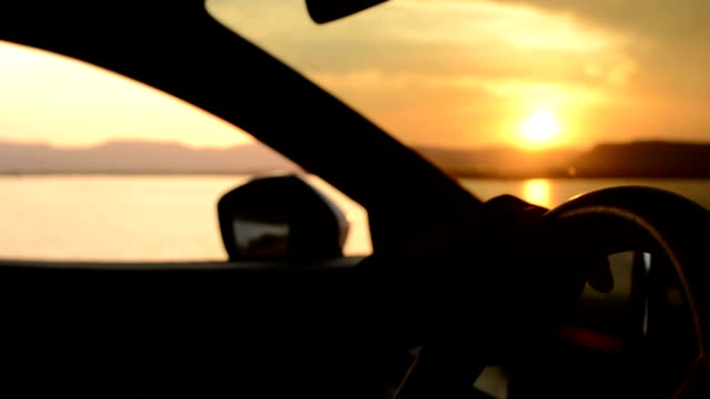 Driver at sunset