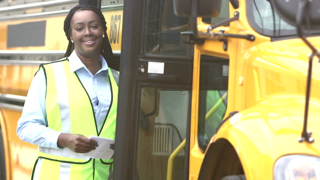 driver climbs aboard school bus - bus driver stock videos & royalty-free footage