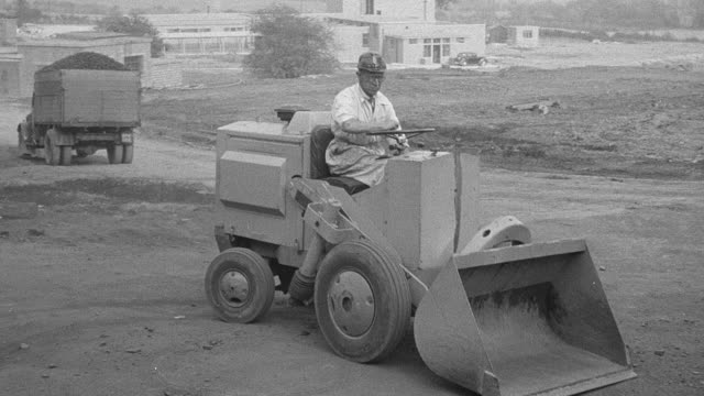 1954 b/w driver demonstrating front-loader scooping dirt during performance trials / arkwright, england, united kingdom - 1954 stock videos & royalty-free footage