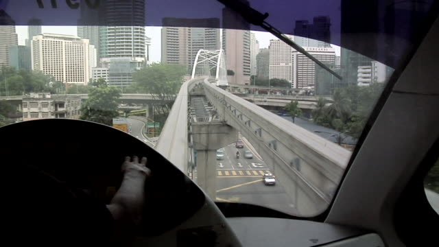 MS POV Driver driving monorail through city / Kuala Lumpur, Malaysia